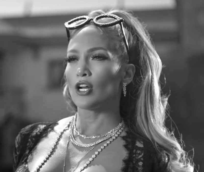 "Female  Celebrity Style:  Black Bra, Necklaces, Earrings and Sunglasses Worn by Jennifer Lopez in ""Dinero"" Official Music Video"