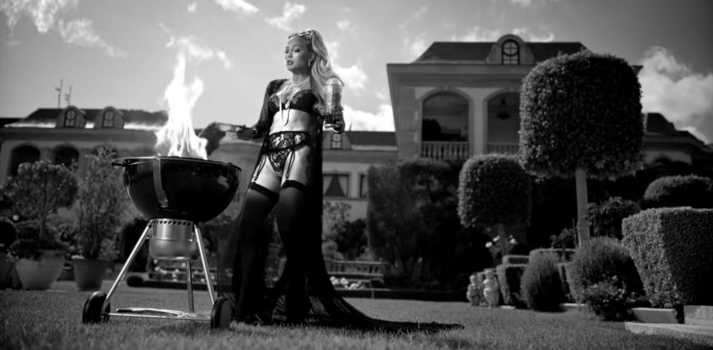 """Fashion Trends 2021: Black Lingerie and Stockings Worn by Jennifer Lopez in """"Dinero"""" Music Video"""