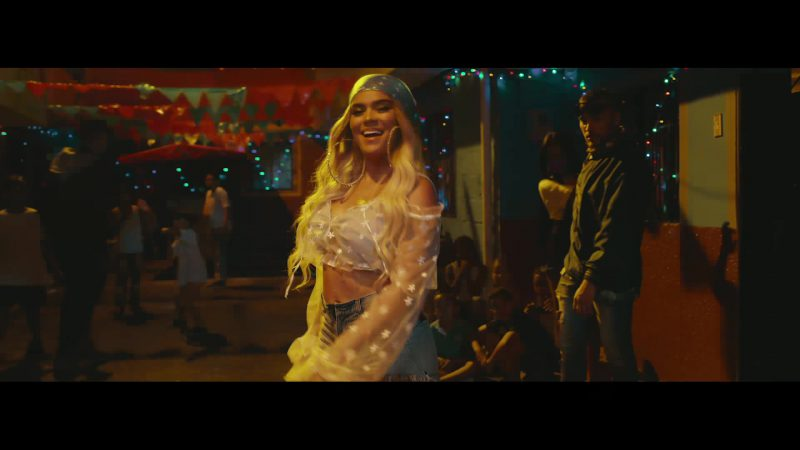 Fashion Trends 2021: Cropped Top and Denim Shorts Worn by Karol G in Mi Cama Music Video