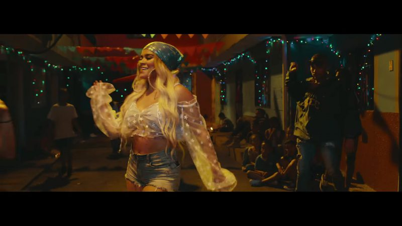 Cropped Top and Denim Shorts Worn by Karol G in Mi Cama Music Video