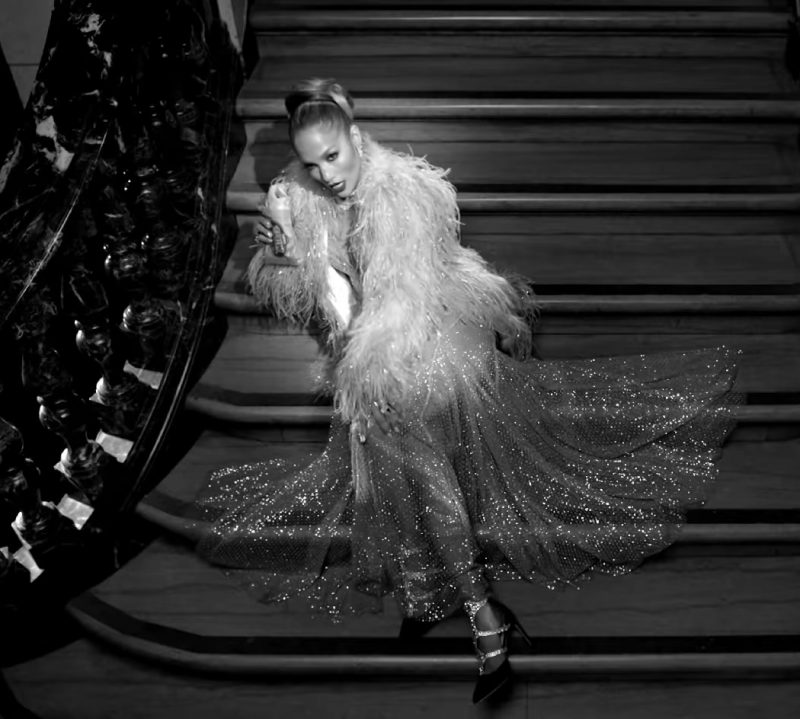 """Fashion Trends 2021: Evening Dress, Faux Fur Coat and Pumps Worn by Jennifer Lopez in """"Dinero"""" Music Video"""