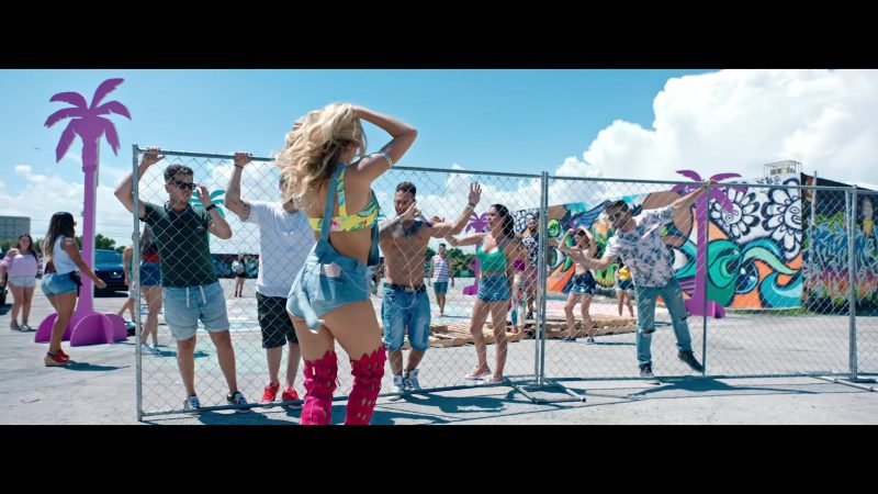 "Printed Yellow Crop Top and Denim Overall Shorts Worn by Model in ""Única"" by Ozuna Music Video - Female Fashion Outfits and Products"