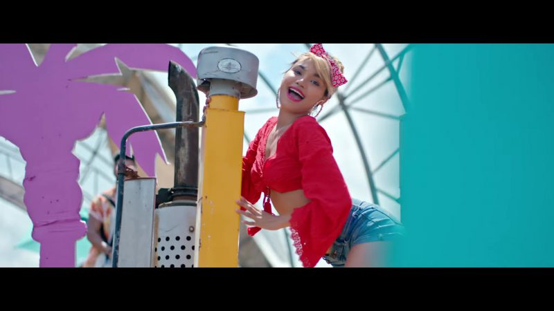 "Red Crop Top and Denim Shorts Worn by Model in ""Única"" by Ozuna Music Video"