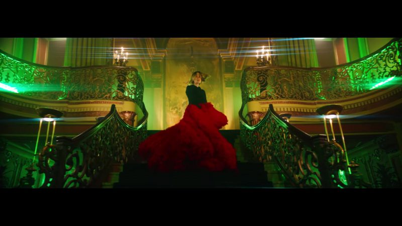 "Red Skirts and Black Hoodie Worn by Olivia Wilde in ""Nice For What"" Music Video by Drake"