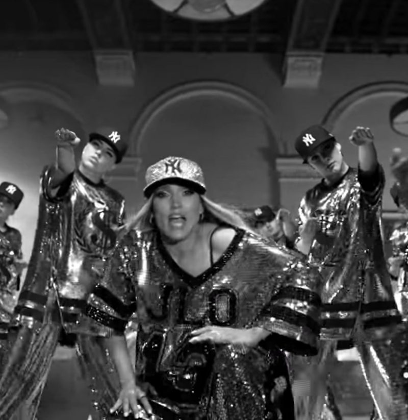 "Sequin Jersey and Sparkly Cap Worn by Jennifer Lopez in ""Dinero"" Music Video"