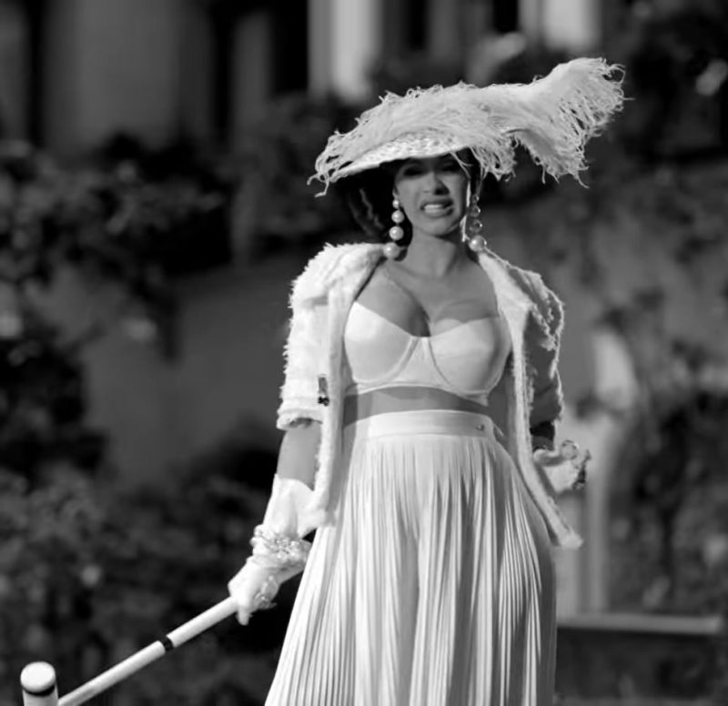 Fashion Trends 2021: White Jacket, Bra, Skirt and Hat Worn by Cardi B in Dinero by Jennifer Lopez ft. DJ Khaled Official Music Video
