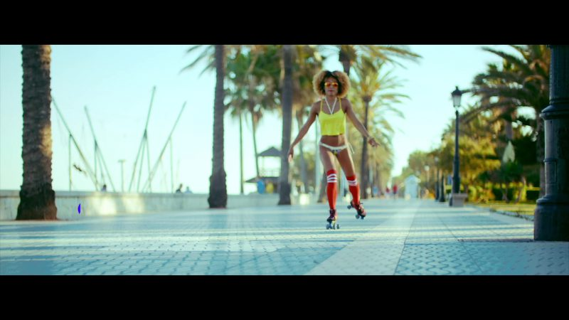"""Yellow Crop Top Worn by Model in """"Única"""" by Ozuna Music Video - Youtube Outfits and Products"""