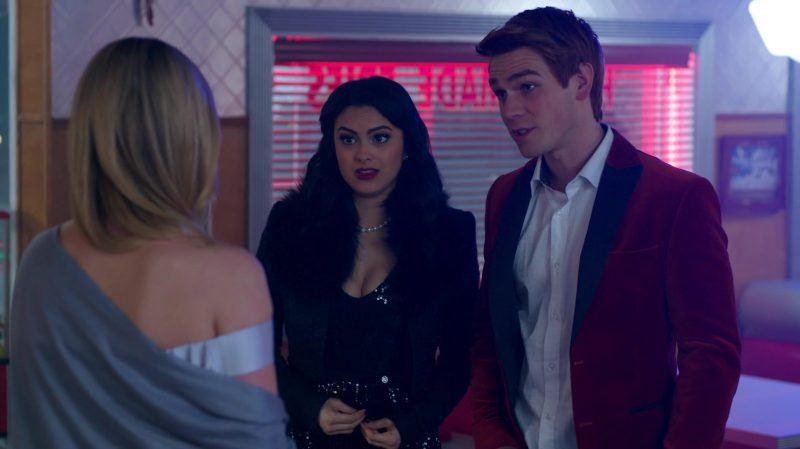 """Fashion Trends 2021: Black Sparkly Dress and Jacket With Fur Collar Worn by Camila Mendes in """"Riverdale"""""""