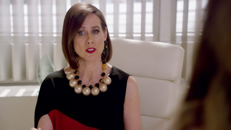 """Black and Red Asymmetric Sleeve Top and Jewelry Worn by Miriam Shor in """"Younger"""" - TV Show Outfits and Products"""