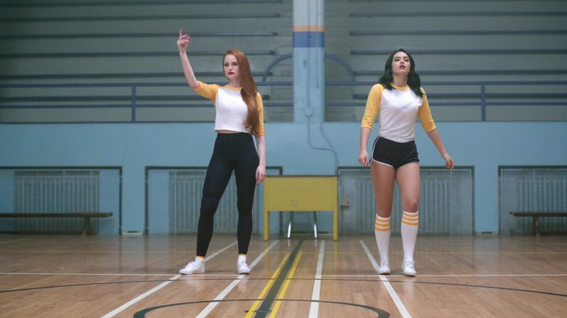 """Fashion Trends 2021: Long Sleeve T-Shirt And Black Shorts Worn by Camila Mendes in """"Riverdale"""""""