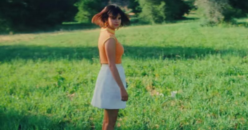"""Orange Tee and White Skirt Worn by Selena Gomez in """"Back To You"""" Music Video - Female Fashion"""