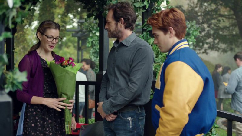 "Purple Cardigan And Black Floral Dress Worn by Sarah Habel in ""Riverdale"" TV Show"