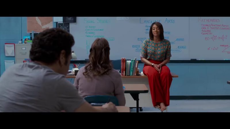 """Fashion Trends 2021: Red High Waist Wide Leg Trousers and Floral Top Worn by Tiffany Haddish in """"Night School"""""""