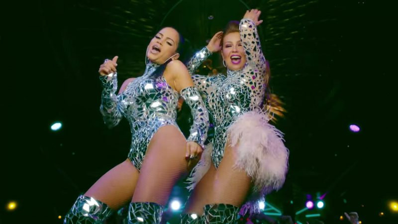 "Sequin & Glitter Outfits Worn by Thalía and Natti Natasha in ""No Me Acuerdo"" Music Video"