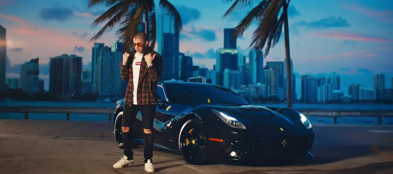 "Supreme Tee, Flannel Shirt and Black Ripped Jeans Worn by Bad Bunny in ""Dime Si Te Acuerda"" Official Music Video"