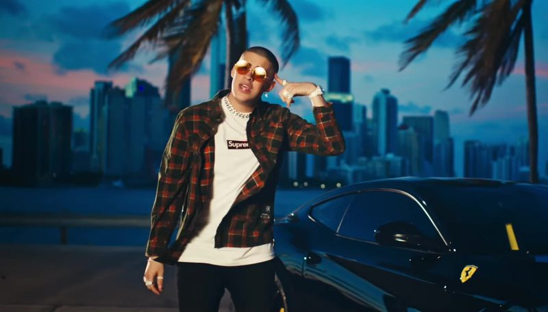 "Supreme White T-Shirt and Tartan Shirt Worn by Bad Bunny in ""Dime Si Te Acuerda"" Official Music Video"