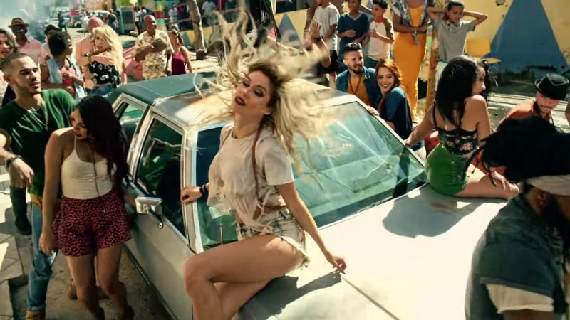 """White Top and Cut-Off Denim Shorts Worn by Model in """"Despacito"""" Music Video by Luis Fonsi ft. Daddy Yankee - Youtube Outfits and Products"""
