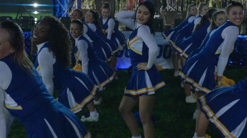 "White Turtleneck and Cheerleading Dress Worn by Camila Mendes in ""Riverdale"" TV Show"
