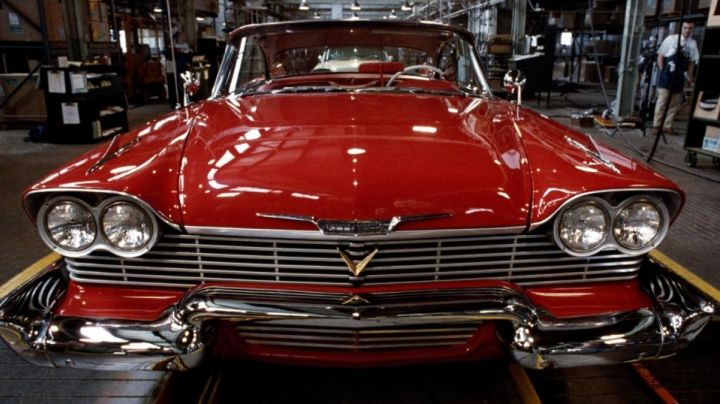 1957 Red Plymouth Fury driven by Arnold Cunningham / Arnie (Keith Gordon) as seen in Christine - Movie Outfits and Products
