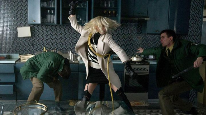 Fashion Trends 2021: Black and White Sweater worn by Lorraine Broughton (Charlize Theron) as seen in Atomic Blonde