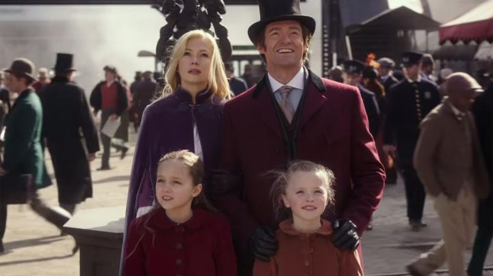 Burgundy coat worn by P.T. Barnum (Hugh Jackman) as seen in The Greatest Showman - Movie Outfits and Products