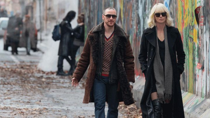 Long Black Coat worn by Lorraine Broughton (Charlize Theron) as seen in Atomic Blonde - Movie Outfits and Products
