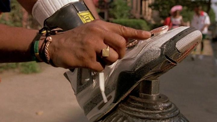 Nike Air Jordan IV White Cement shoes worn by Buggin Out (Giancarlo Esposito) as seen in Do the Right Thing - Movie Outfits and Products