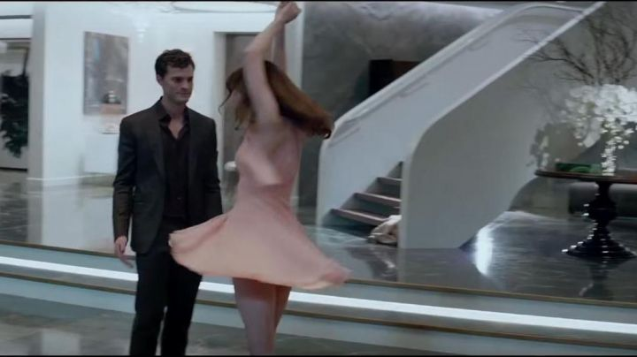 Pink Halter chiffon Dress worn by Anastasia steele(Dakota Johnson)in Fifty shades of grey - Movie Outfits and Products