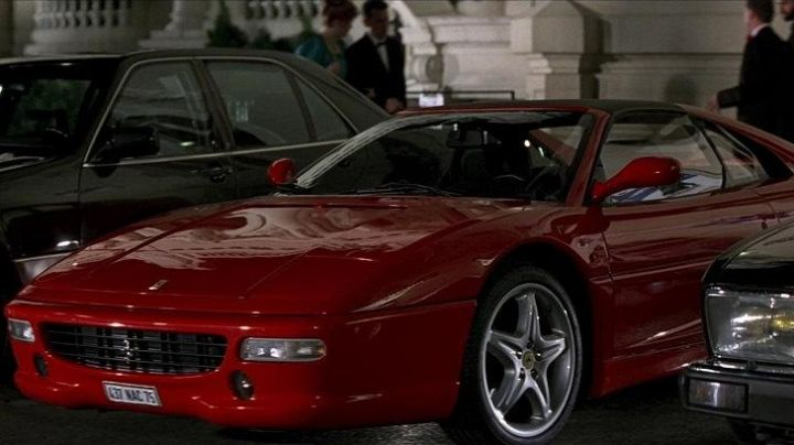 Red Ferrari F355 GTS driven by Xenia Onatopp (Famke Janssen) as seen in GoldenEye - Movie Outfits and Products