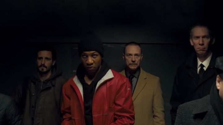 Red jacket worn by Rafe (Jonathan Majors) as seen in Captive State movie