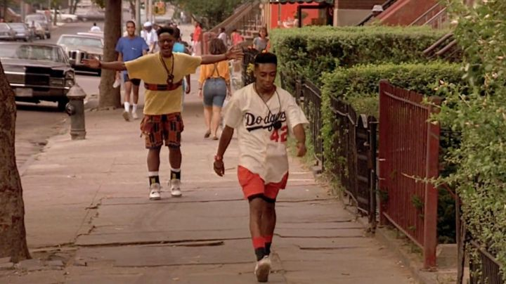 Fashion Trends 2021: Sneakers Nike Air Jordan 4 retro OG white cement worn by Bugging Out (Giancarlo Esposito) in Do the right thing