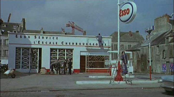 Station service Esso in 78 Quai Alexandre 3 in The Umbrellas of Cherbourg - Movie Outfits and Products