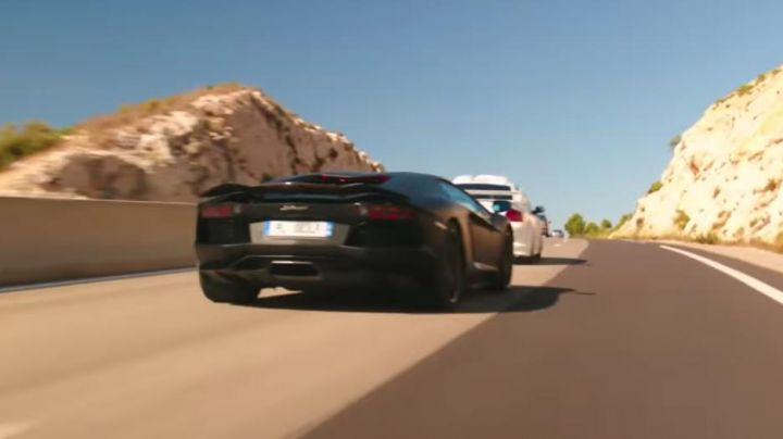 The 2012 Lamborghini Aventador LP 700-4 black view during a chase in Taxi 5 - Movie Outfits and Products