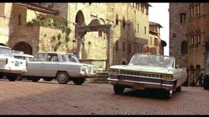 The Piazza della Cisterna of San Gimignano in Italy in the film le Corniaud - Movie Outfits and Products