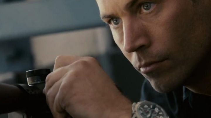 The Porsche Design watch Indicator John Rahway (Paul Walker) in Takers - Movie Outfits and Products