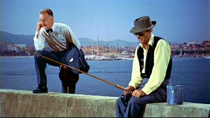 The Quai du Large, and its lighthouse at Cannes in hand in The collar of Alfred Hitchcock - Movie Outfits and Products