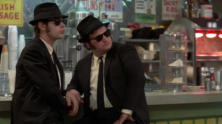The black hat Trilby Elwood Blues (Dan Aykroyd) and 'Joliet' Jake Blues (John Belushi) in The Blues Brothers - Movie Outfits and Products