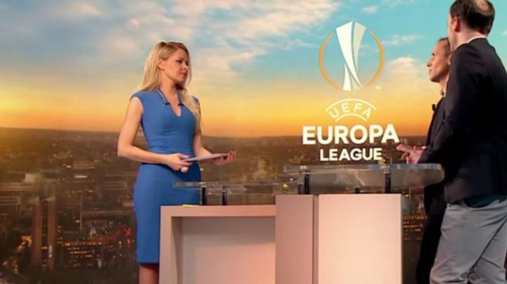 The blue dress of Carine Galli in The Europa League, W9 of the 22/02/2018 - Movie Outfits and Products