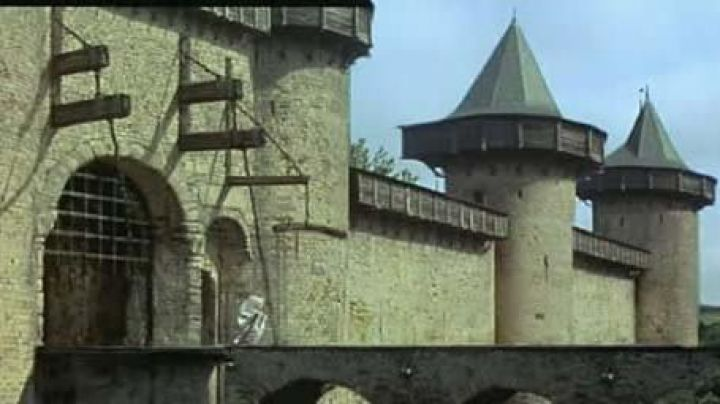The château Comtal of the cité de Carcassonne deposited on top of a hill in The Visitors - Movie Outfits and Products