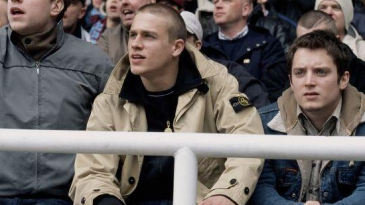 Fashion Trends 2021: The coat trench coat Stone Island Pete Dunham (Charlie Hunnam) in Hooligans