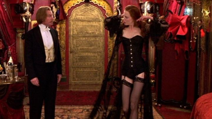 The dressing gown is black lace of Satine (Nicole Kidman) in Moulin Rouge Movie