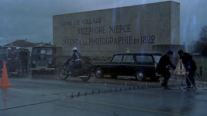 The entrance to the village of Saint-Loup-de-Varennes in the movie The Red Circle - Movie Outfits and Products