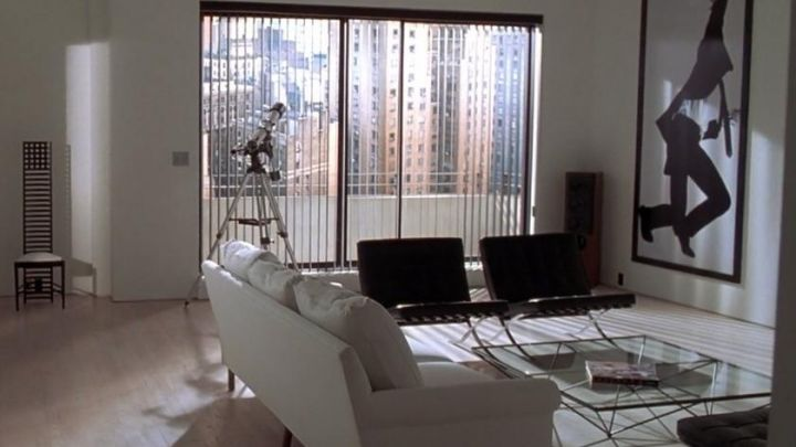 The glass table in the living room of Patrick Bateman (Christian Bale) in American Psycho Movie