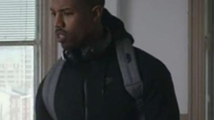 The jacket jogging Nike black worn by Adonis Creed (Michael B Jordan) in Creed : The legacy of Rocky Balboa