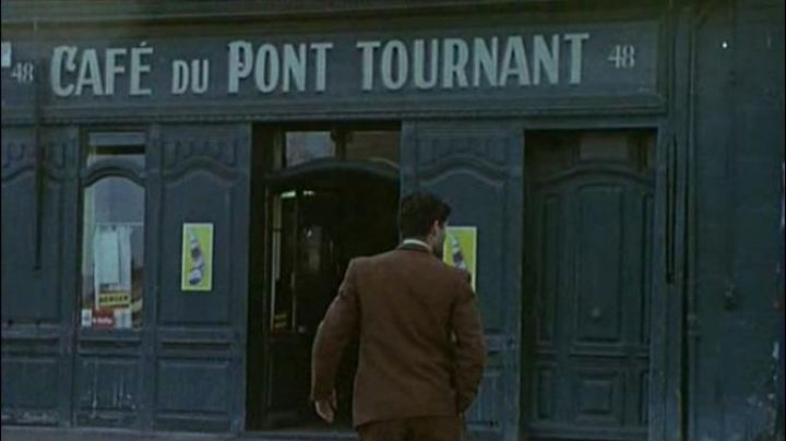 The old Café of the swing bridge at 48 Quai Caligny in The umbrellas of Cherbourg - Movie Outfits and Products