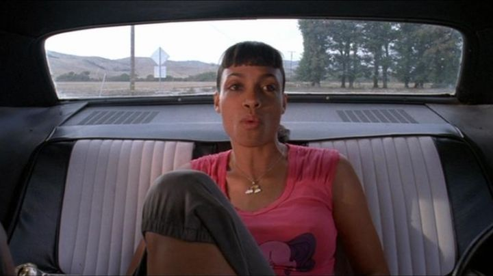 "The pendant rainbow of Abernathy (Rosario Dawson) in "" Boulevard of Death (Death Proof) movie"