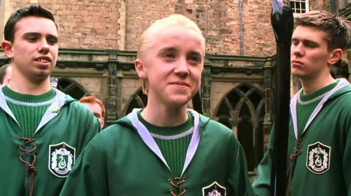 The pull of Quidditch house Slytherin Draco Malfoy (Tom Felton) in Harry Potter and the goblet of fire Movie