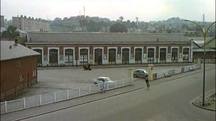 The railway station of Cherbourg, Avenue Jean-François Millet at Cherbourg-Octeville in The umbrellas of Cherbourg - Movie Outfits and Products