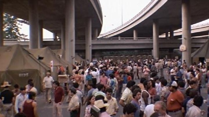 The reception of refugees under the Santa Monica Freeway in Los Angeles in Scraface - Movie Outfits and Products