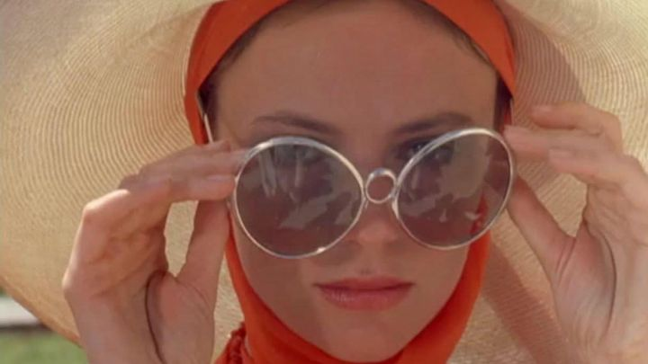 The round sunglasses oversize Tatiana (Jacqueline Bisset) in The Beautiful movie